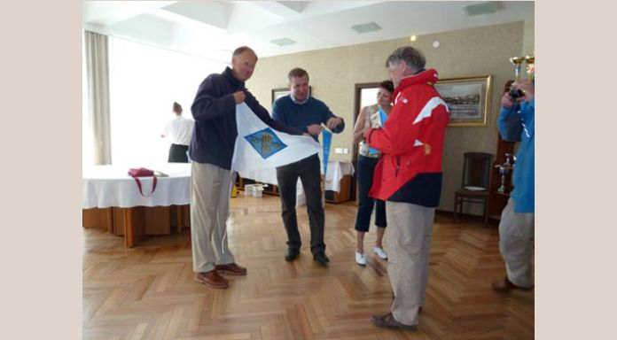 Exchanging burgees with the St. Petersburg River Yacht Club
