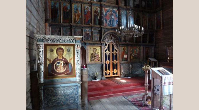 Interior of old wooden church on lake site Kondaponga